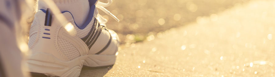 jogging shoes on road
